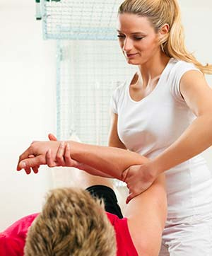 Physical Therapist examining a patient