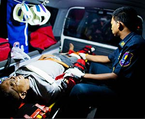 EMT treating patient in an ambulance