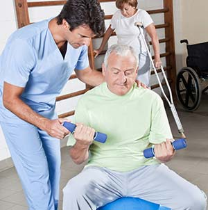 An elderly man training with his physical therapist