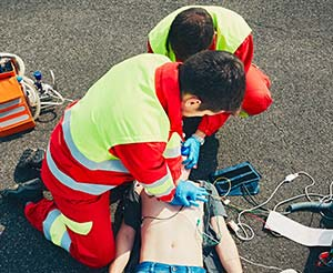 Paramerdic administering emergency treatment