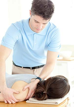 Physical Therapist engaged in treatment of a patient